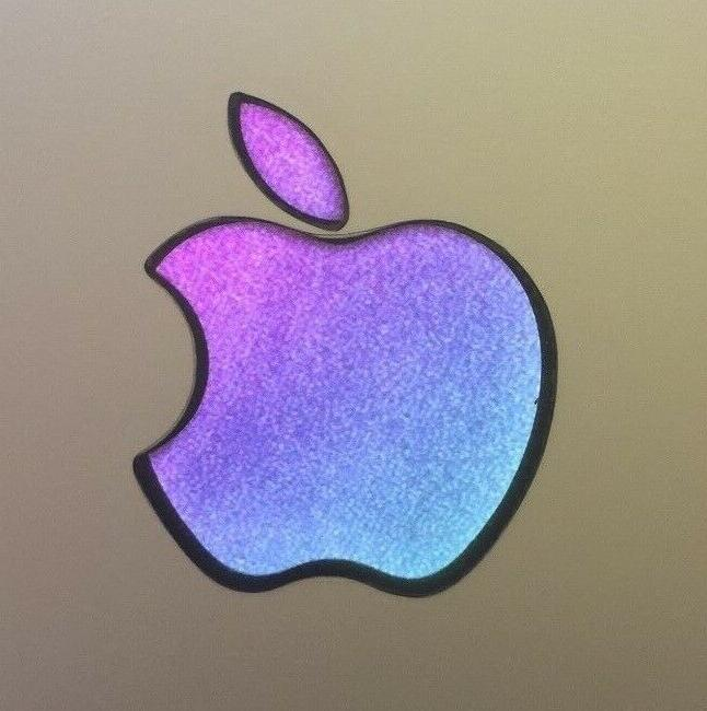 glowing purple teal apple macbook pro air